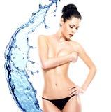Beautiful sexy female body over water splash Stock Photography