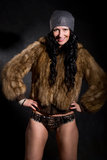 Beautiful sexy female in fur coat Royalty Free Stock Image