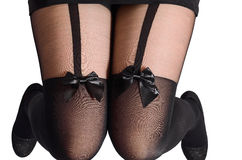 Beautiful sexy female legs in black tights with a butterfly Royalty Free Stock Photos