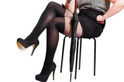Beautiful sexy female legs in black tights with a butterfly Royalty Free Stock Photography
