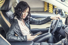 Beautiful sexy female model in leather clothes with a white car Royalty Free Stock Photo