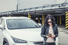 Beautiful sexy female model in leather clothes with a white car Royalty Free Stock Photos