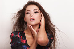 Beautiful sexy female model touching her face Royalty Free Stock Images