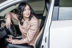 Beautiful sexy female model with a white car in the Parking lot Royalty Free Stock Photography