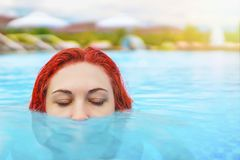 Woman swimming in the pool. royalty free stock photo