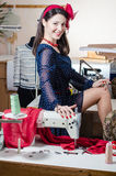 Beautiful sexy funny young pinup woman with sewing machine Royalty Free Stock Photo