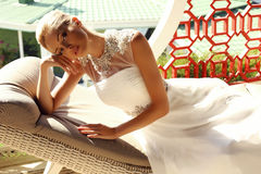 Beautiful sexy girl with blond hair in elegant wedding dress Stock Photo