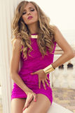 Beautiful sexy girl with blond hair in pink dress Royalty Free Stock Photos
