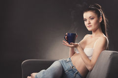 Beautiful sexy girl in bra with cup of coffee Stock Image