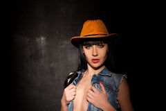 Beautiful sexy girl in cowboy hat and denim Royalty Free Stock Image