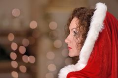 Beautiful sexy girl with curly hair in Santa Claus clothes Stock Image