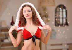 Beautiful sexy girl with curly hair in Santa Claus clothes Stock Images