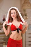 Beautiful sexy girl with curly hair in Santa Claus clothes Royalty Free Stock Photography