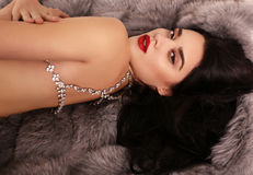 Beautiful sexy girl with dark hair with luxurious bijou necklace Royalty Free Stock Image