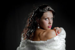 Beautiful sexy girl in fur coat on black Stock Images