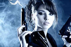 Beautiful girl holding gun stock photo