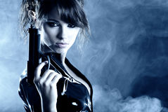 Beautiful sexy girl holding gun Stock Photos