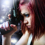 Beautiful sexy girl holding gun Royalty Free Stock Photo