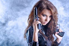 Beautiful sexy girl holding gun Royalty Free Stock Photos