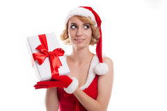 Beautiful girl holds Santa Claus gift  on a white backgroun Stock Image