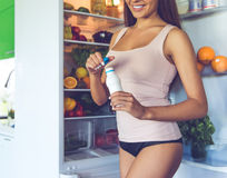 Beautiful girl in the kitchen stock image