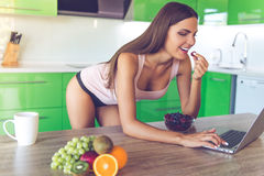 Beautiful sexy girl in the kitchen Stock Photography