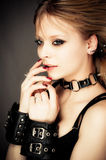 Girl in leather handcuffs Stock Photo