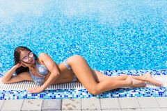 Free Beautiful Sexy Girl Lies On The Edge Of The Swimming Pool Sunbathing. Summer Vocation. Royalty Free Stock Photo - 97735045