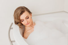 Beautiful sexy girl long hair in the bath with Royalty Free Stock Photo