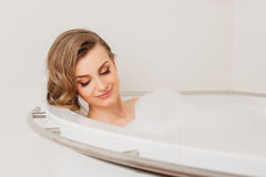 Beautiful sexy girl long hair in the bath with Royalty Free Stock Photos