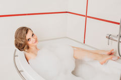 Beautiful sexy girl long hair in the bath with Royalty Free Stock Images