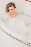 Beautiful sexy girl long hair in the bath with Stock Photography