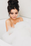 Beautiful sexy girl long hair in the bath with Royalty Free Stock Image