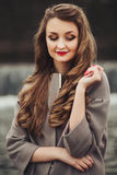 Beautiful girl with long hair in a man's shirt royalty free stock image