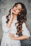 Beautiful sexy girl with long hair in a man's shirt Royalty Free Stock Images