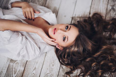 Beautiful sexy girl with long hair in a man's shirt Stock Photography
