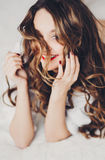 Beautiful sexy girl with long hair in a man's shirt Stock Images