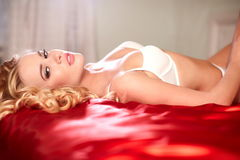 Beautiful sexy girl lying on the bed Royalty Free Stock Photos