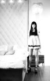 Beautiful sexy girl maid near a bed Stock Photo