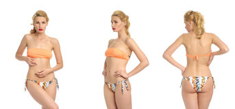 Beautiful sexy girl in a orange bathing suit isolated on white Stock Photography