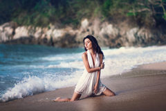 The beautiful sexy girl posing on the beach Royalty Free Stock Images