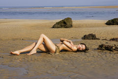 Beautiful sexy girl posing on the beach Stock Photography