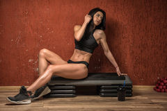 Beautiful girl posing in the gym stock photo