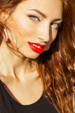 Beautiful girl with red hair with big red lips with makeup in the city on a Sunny summer day Stock Image