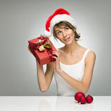 Beautiful girl in santa claus hat Stock Images