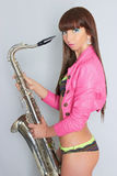 Beautiful sexy girl with saxophone Stock Photography