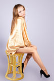 Beautiful sexy girl sitting on a chair. Royalty Free Stock Photo