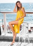 Beautiful girl smiling in a yellow dress stock images