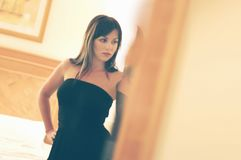 Beautiful girl standing at the bedroom door , out of shar royalty free stock photography