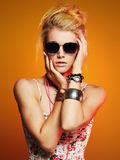 Beautiful sexy girl in sunglasses.beauty woman.orange background Stock Photography